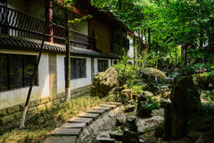 Shady flagstone path before Chinese traditional buildings in sun Royalty Free Stock Photos