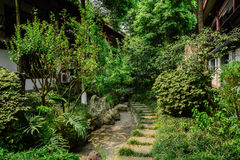 Shady flagstone path between old-fashioned Chinese dwellingl bui Royalty Free Stock Photography