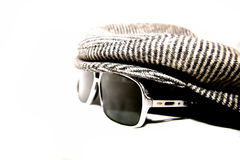 Shady hat. Picture of sunglasses and a cap royalty free stock photo