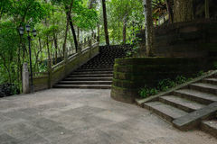 Shady hillside stone stairways before ancient Chinese building i Royalty Free Stock Photography