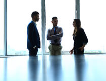 Shady image of a manager discussing business matters. With his subordinates Royalty Free Stock Photography