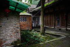 Shady lichen-covered alley in ancient Chinese dwelling buildings Stock Photography