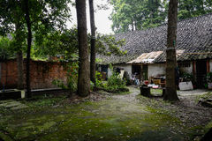 Shady lichen-covered yard of ancient Chinese dwelling building Royalty Free Stock Image