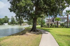 Lakeside residential house in Houston, Texas, USA. Shady path leads to residential houses by the lake in Houston, Texas, USA Stock Photography