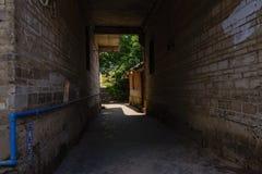 Shady red brick passageway at sunny summer noon. Shiqiao town,Jianyang City,Chengdu Stock Images
