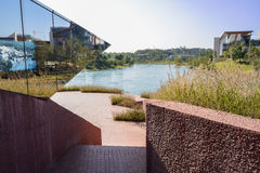 Shady stairway beside lakeside modern building at sunny winter n Royalty Free Stock Photo