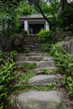 Shady stone stairway to hilltop aged Chinese building Stock Image