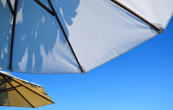 Shady under big umbrellas Royalty Free Stock Photos