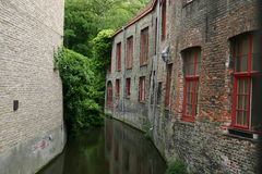 A shady water canal in Brugges Stock Photo