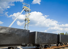 Shaft mine and mining cars. Shaft tower of a coal mine with mining cars Stock Images
