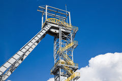 Shaft mine. Shaft tower of a coal mine with white cloud Stock Photo
