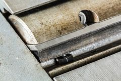 Shaft with sharp knives of woodworking jointer сlose-up Royalty Free Stock Images