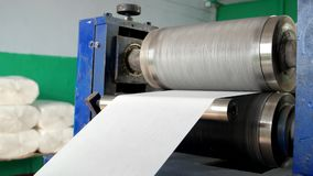 Shaft which pushes a relief pattern on paper. Embossing pattern on napkins. plant for the production of napkins. recycled use in the manufacture of paper stock footage