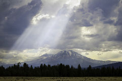 Shafts of Light. Shine through clouds gathered around these mountains in the Oregon Cascades Range Stock Images