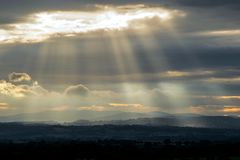 Shafts of light. Shafts of sunlight illuminating the welsh hills Royalty Free Stock Photos