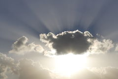 Shafts of sunlight. Behind clouds Stock Photography