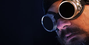 Shag beard and mustache man with goggles - copy space Stock Photo
