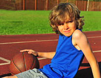 Shaggy boy on the court with basketball Royalty Free Stock Photography