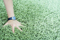 Shaggy carpet and watch Stock Photo