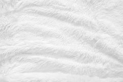 Shaggy fur texture. White shaggy blanket texture as background. Fluffy fake textile fur stock photography