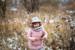 Shaggy girl in jacket, gray scarf and fedora hat Royalty Free Stock Photography