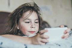 Ruffled girl in the morning. Shaggy sleepy offended child in the morning Royalty Free Stock Photography