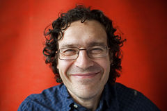 Shaggy and unshaven smiling man with glasses Royalty Free Stock Photos