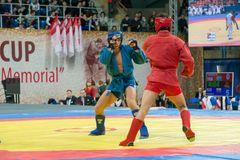 Shagin Vadim (azul) contra Nurlikov Mekan Imagem de Stock