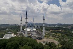 Aerial Video of Sultan Salahuddin Abdul Aziz Shah Mosque. SHAH ALAM, MALAYSIA - 8 JANUARY 2018 - An aerial photo of Blue Mosque, Shah Alam, Malaysia. Blue Mosque Royalty Free Stock Photography