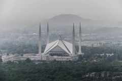 Shah Faisal mosque is the masjid in Islamabad, Pakistan. Located on the foothills of Margalla Hills. The largest mosque design of. Islamic architecture royalty free stock photo
