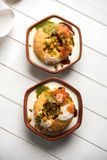 Shahi Raj Kachori is a popular chat item from India. Shahi Raj Kachori is a popular chat item from Rajasthan served in terracotta bowl, India Stock Image