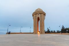 Shahidlar Monument or Eternal flame Monument on Martyrs` Lane in the evening. Baku. Azerbaijan. Baku, Azerbaijan - March 11, 2018: Shahidlar Monument or Eternal stock photography
