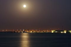 Shaikh Khalifa bridge and super moon at Bahrain on 23 June 2013 Stock Photos