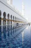 Shaikh Zayed mosque in Emirates. Decoration of the grand mosque with a pool surrounding the prayer hall Royalty Free Stock Photography