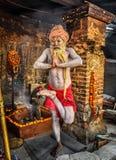 Shaiva sadhu (holy man)  exercises in Pashupatinath Temple, Kathmandu Stock Photos