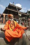 Shaiva sadhu (holy man) seeking alms in  a temple Royalty Free Stock Photography