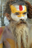 Shaiva sadhu seeking alms in front of a temple Royalty Free Stock Images