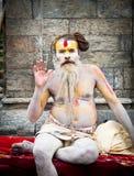 Shaiva sadhu seeks alms on the Pashupatinath Temple in Kathmandu Royalty Free Stock Photos