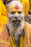 Shaiva sadhu smiling and posing on the street Royalty Free Stock Photos