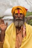 Shaiva sadhu smiling and posing on the street Stock Image