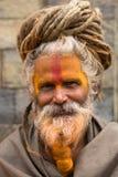 Shaiva sadhu smiling and posing on the street Stock Photos
