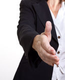 Shake on it. Older senior business woman's arthritic hand with knobbly fingers in a welcoming hand gesture Stock Image