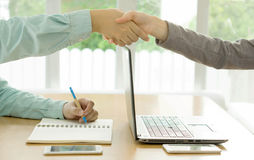 Shake of business partners after striking deal Stock Image