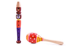 Shake with the flute. Bear flute and colorful rattle shaker isolated over white Royalty Free Stock Photography