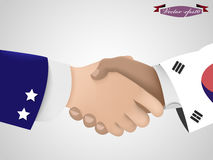 Shake hand between American guy and Korean guy Stock Images