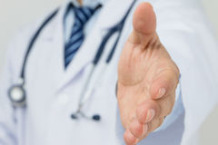 Shake hand. Doctor ready to shake hand Royalty Free Stock Images