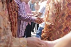 Shake hand in muslim celebration royalty free stock photo