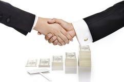 Shake hand over money Royalty Free Stock Photography
