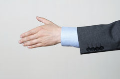 Shake Hands. Businessman Reaching Out To Shake Hands Stock Photo