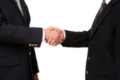 Shake hands. Two business leader shake hand against white background Royalty Free Stock Photos